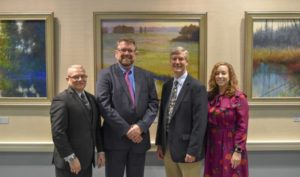 Recognizing Nick Serratore's works for the Art at the Archives program are (l-r) State Archivist and Delaware Public Archives Director Stephen Marz, Serratore, Delaware Division of the Arts Director Paul Weagraff and Deputy Secretary of State Dr. Courtney Stewart. SUBMITTED PHOTO